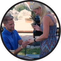 Photo of couple getting engaged in Kansas city with a caricature