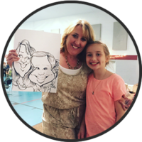 Mom and daughter holding caricature from Bax Illustration in St. Louis