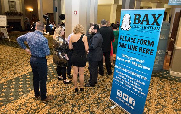 Photo of people waiting in line for caricature from Bax Illustration at wedding in St. Louis