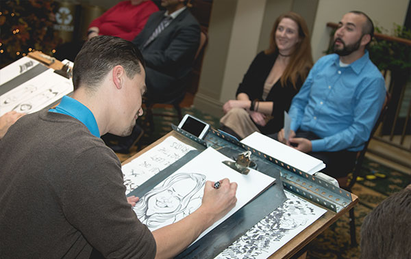 Photo of Bax Illustration Cariature Artist drawing couple at rehearsal dinner in St. Louis
