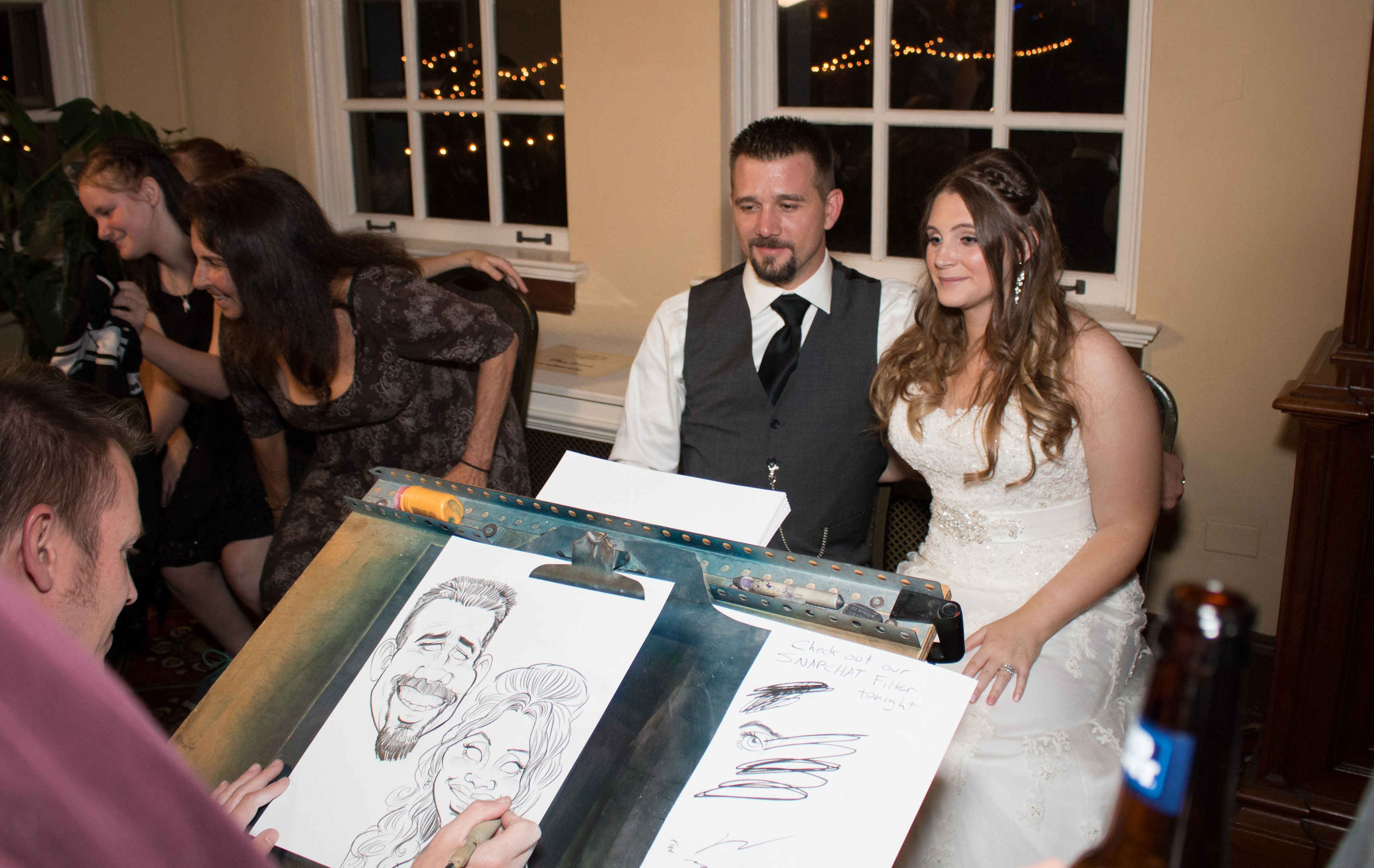 Wedding couple in st. louis getting caricature drawn by Bax Illustration