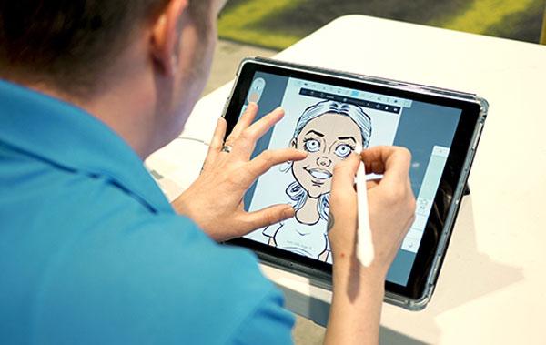 Photo of bax illustration caricaturist doing digital caricatures