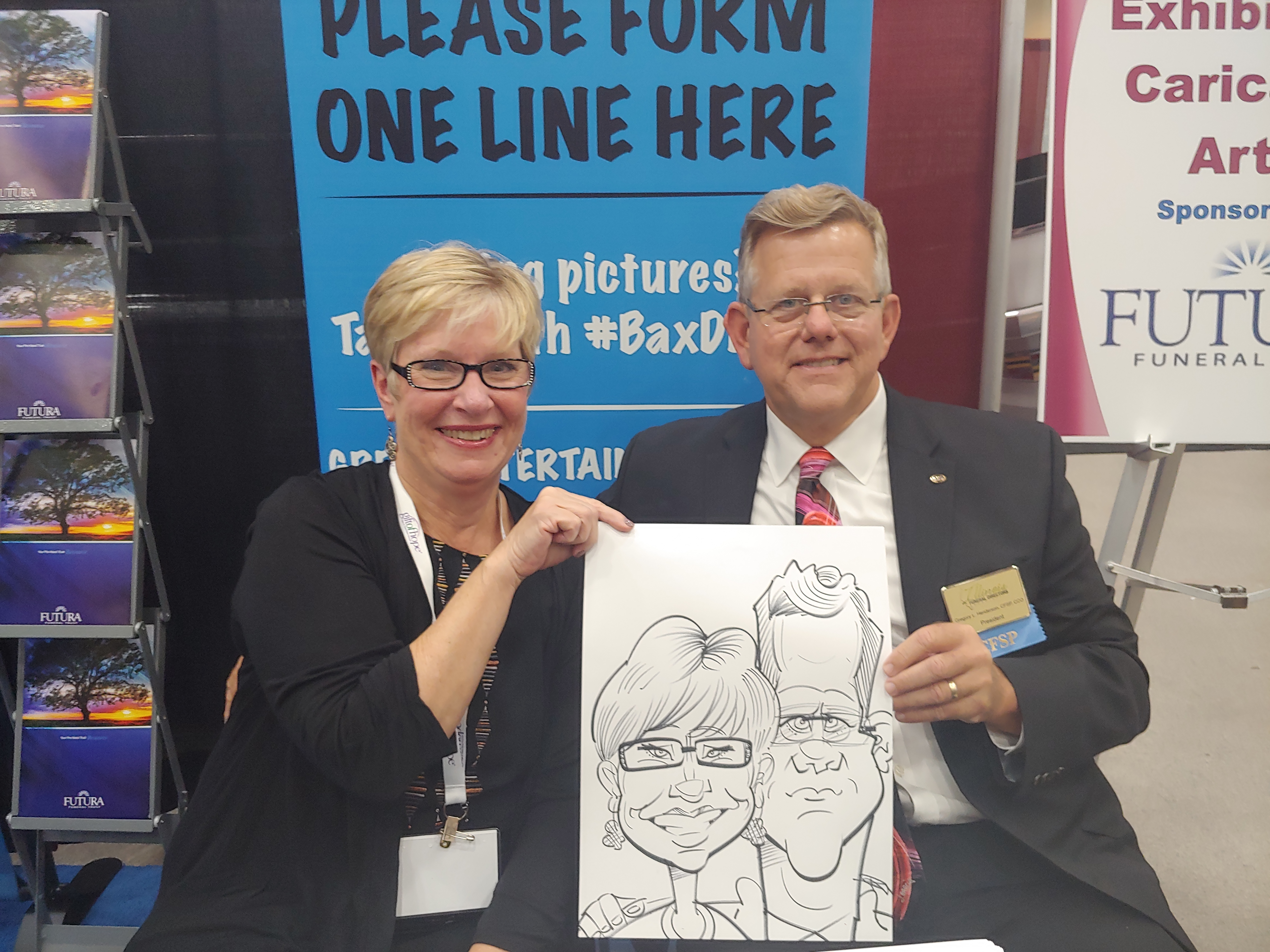 Couple holding caricature at Gateway Center Collinsville during the Illinois Funeral Directors Association Conference