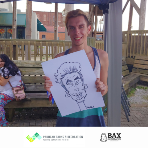 Guy holding caricature by Bax Illustration in Paducah Kentucky at the 2019 Independence Day Celebration