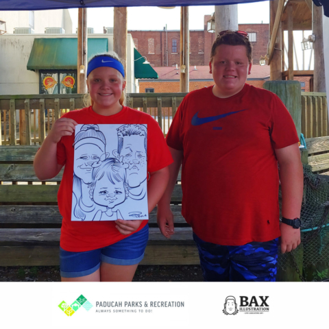 guy and girl holding caricature by Bax Illustration in Paducah Kentucky at the 2019 Independence Day Celebration