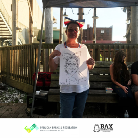 Woman holding caricature by Bax Illustration in Paducah Kentucky at the 2019 Independence Day Celebration
