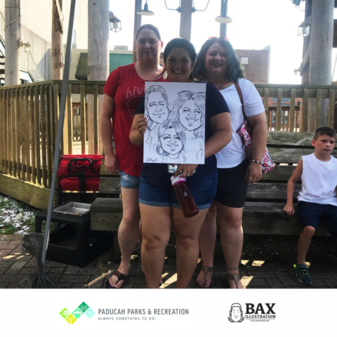 Girls holding caricature by Bax Illustration in Paducah Kentucky at the 2019 Independence Day Celebration