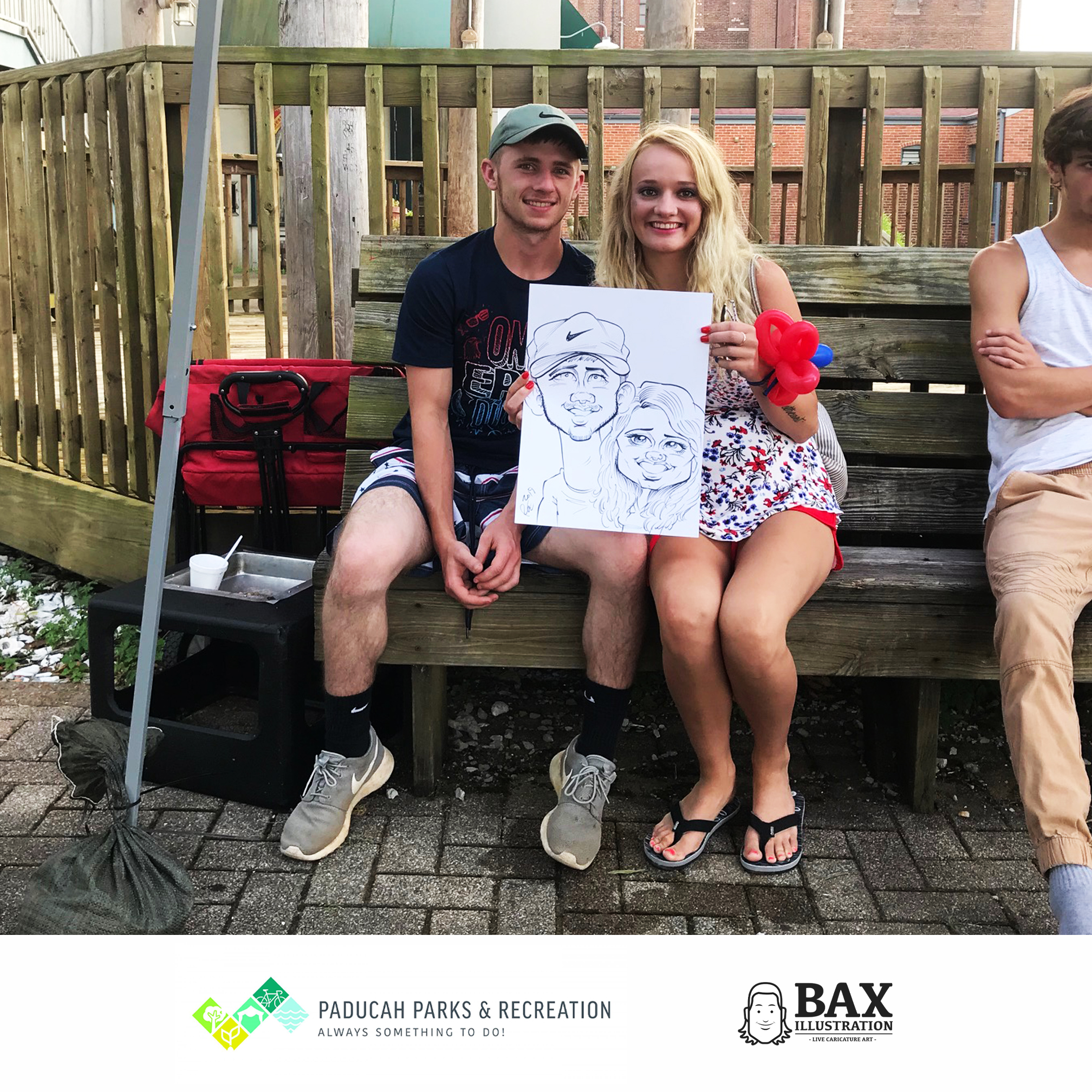 Couple holding caricature by Bax Illustration in Paducah Kentucky at the 2019 Independence Day Celebration