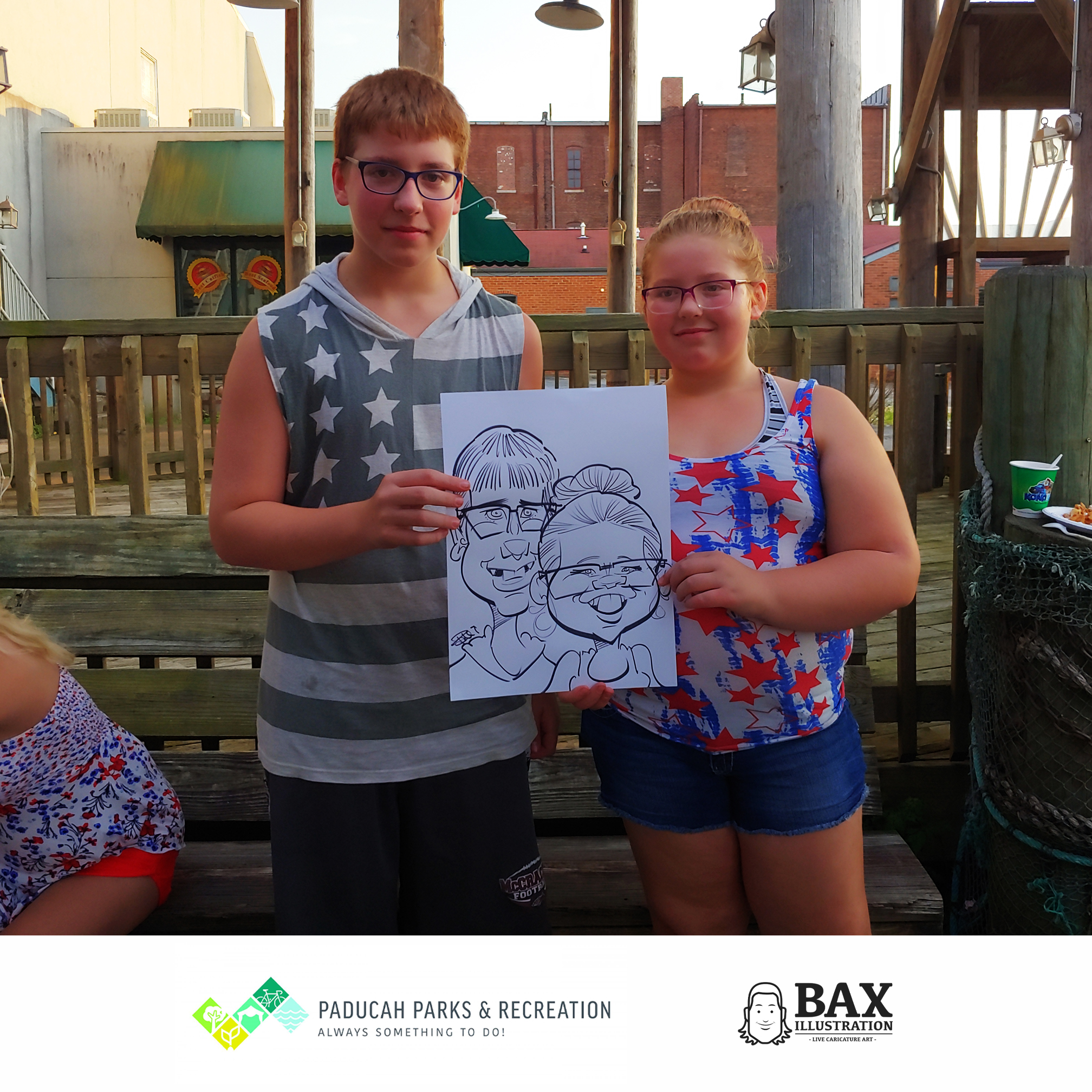 Kids holding caricature by Bax Illustration in Paducah Kentucky at the 2019 Independence Day Celebration