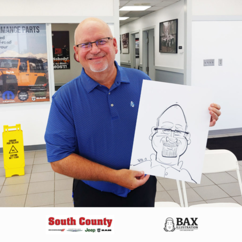 Guy holding caricature by Bax Illustration at South County Dodge Customer Appreciation Event in St. Louis